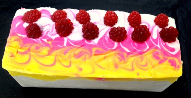A loaf of Raspberry soap with MP raspberries on top